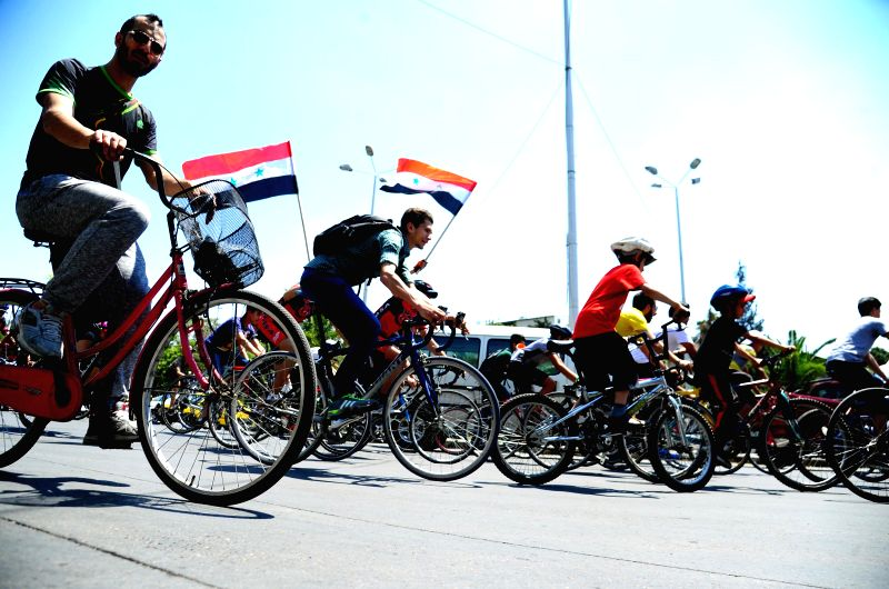DAMASCUS, May 6, 2017 - A group of Syrians take part in a cycling marathon to mark the Martyrs' Day in Damascus, capital of Syria, on May 6, 2017.