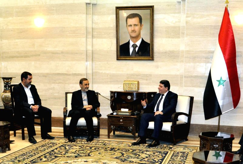 DAMASCUS, May 7, 2016 - Syria's Prime Minister Wael al-Halqi (R) meets with Ali Akbar Velayati (2nd, L), advisor to Iran's Supreme Leader on international affairs, in Damascus, Syria, on May 7, 2016. - Wael