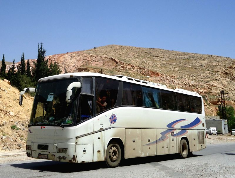 DAMASCUS, May 8, 2017 - Buses transporting rebels and their families leave the Damascus' northern neighborhood Barzeh, Syria, May 8, 2017. As many as 1,022 people evacuated from a northern Damascus' ...