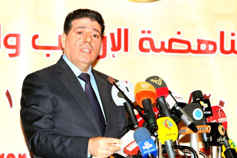 Damascus (Syria): Syrian Prime Minister Wael al-Halqi speaks during the opening session of a conference on combating terrorism and religious extremism in Damascus, Syria on 30 November 2014. The ... - Wael