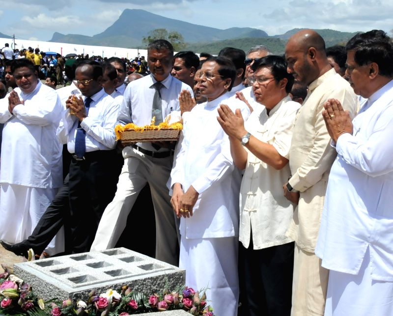 DAMBULLA, July 26, 2016 - Sri Lankan President Maithripala Sirisena (4th R, front) and Chinese Ambassador to Sri Lanka Yi Xianliang (3rd R, front) pray for the project before the laying foundation in ... - Ranil Wickremesingh