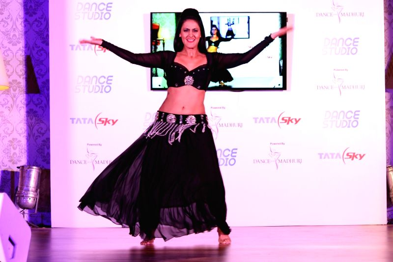 Dancer performs during the launch of Tata Sky's new interactive service 'Dance Studio' in association with RnM Moving Picture in Mumbai on  Dec 10,  2015