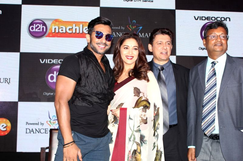 Dancer Terence Lewis, actor Madhuri Dixit Nene with her husband Dr. Shriram Nene during launch of d2h Nachle, an interactive dance service by Videocon d2h in Mumbai on May 10, 2017. - Madhuri Dixit Nene