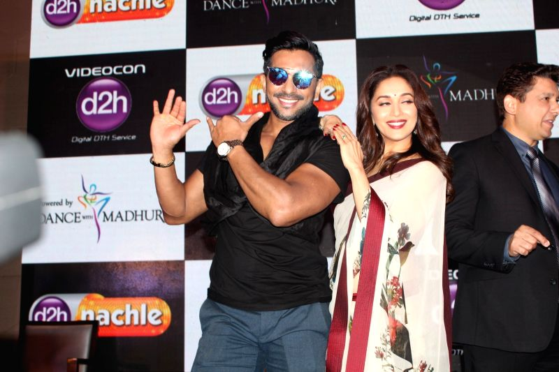 Dancer Terence Lewis and actress Madhuri Dixit Nene during launch of d2h Nachle, an interactive dance service by Videocon d2h in Mumbai on May 10, 2017. - Madhuri Dixit Nene