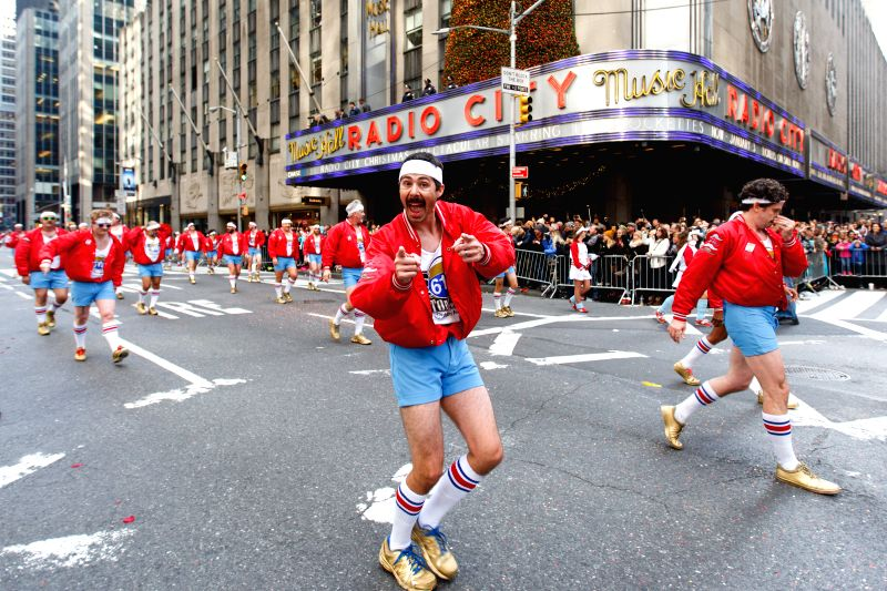 "Dancers from ""610 Stompers"" perform during the 89th Macy's Thanksgiving Day Parade in New York, the United States, Nov. 26, 2015."