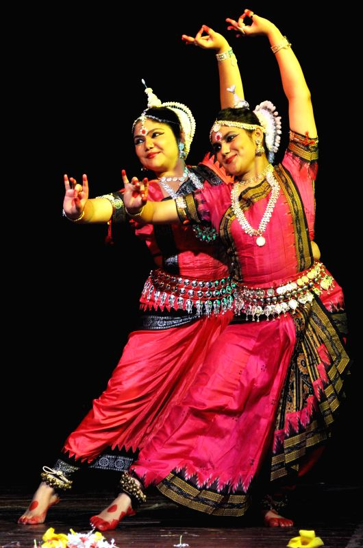 Dancers perform `Odissi`during `Nrittya-Utsav` organised by Prayas Kala Kendra at District Library Auditorium in Guwahati on Sept 3, 2014.