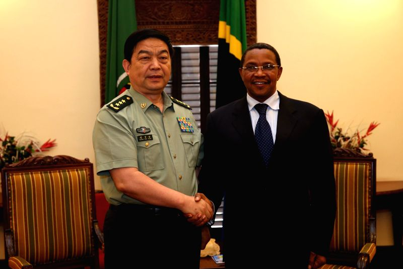 Tanzanian President Jakaya Kikwete (R) shakes hands with visiting Chinese State Councilor and Defense Minister Chang Wanquan during their meeting in Dar es ...