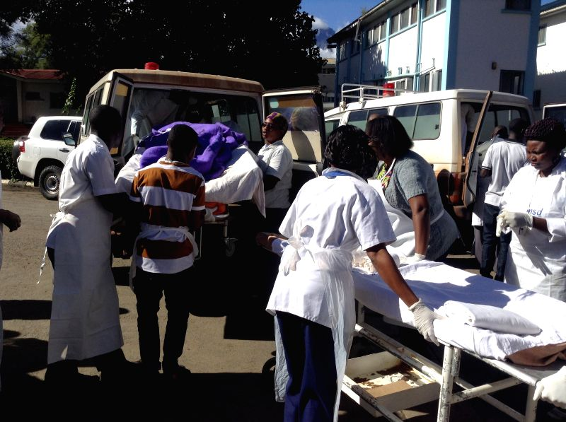 DAR ES SALAAM, May 6, 2017 - People injured in a school bus crash are sent to a nearby hospital for treatment in Karatu District, northern Tanzania, on May 6, 2017. At least 32 people were killed ...