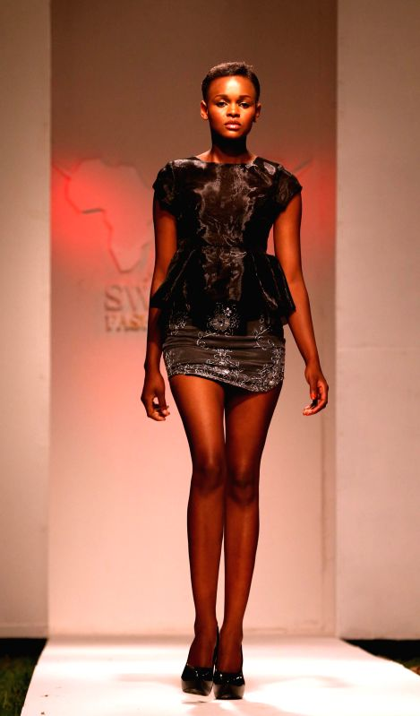 Dar es Salaam (Tanzania): A model presents a creation of an African designer during the Swahili Fashion Week 2014 in Dar es Salaam, Tanzania, Dec. 7, 2014. The Swahili Fashion Show is the largest ...