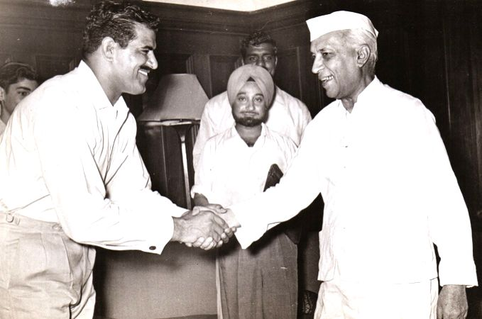 Jawaharlal Nehru on the right