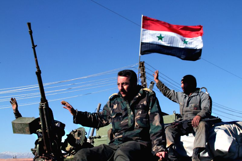 Syrian troops are seen at al-Habaria village in the countryside of the southern province of Daraa, Syria, on Feb. 28, 2015. The Syrian troops on Saturday made new ...