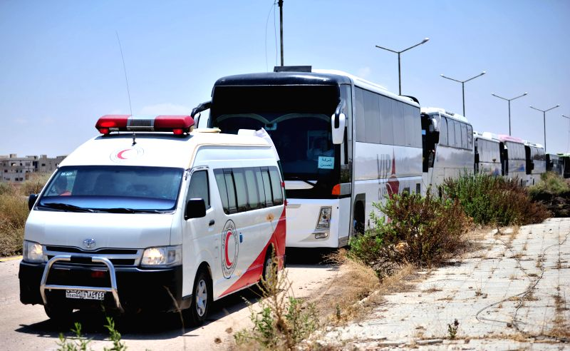 DARAA (SYRIA), July 16, 2018 Buses transporting the rebels and their families are seen in the southern province of Daraa, Syria, on July 15, 2018. Rebels and their families started ...
