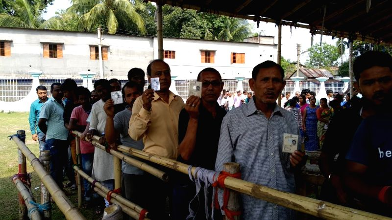 Darjeeling: People wait in queue to cast vote during the second phase of Lok Sabha polls, in West Bengal's Darjeeling, on April 18, 2019.