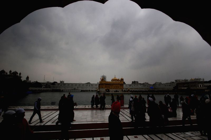 Dark clouds hover over the Golden Temple in Amritsar on Feb 12, 2018.