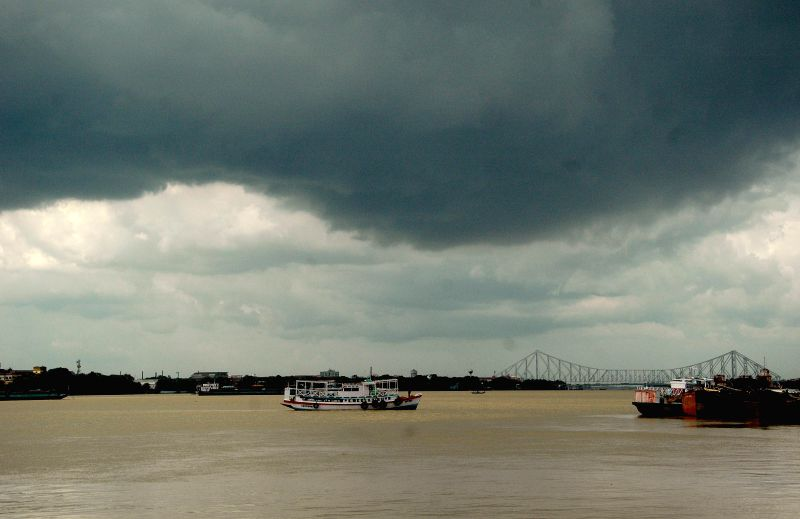 Dark clouds loom over Hooghly river, Kolkata on July 11, 2014.