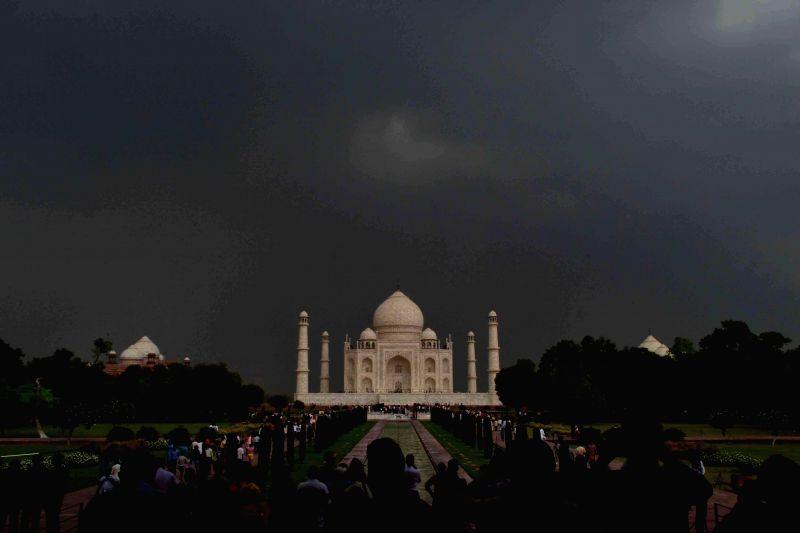 Dark clouds loom over Taj Mahal in Agra on Aug 28, 2014.