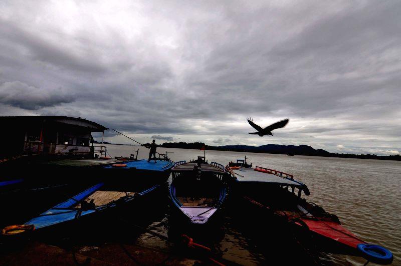 Dark clouds seen over river Brahmaputra, in Guwahati on June 12, 2018.