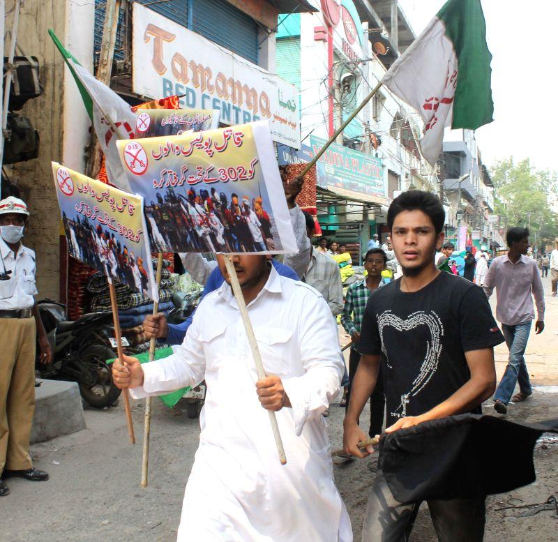 Darsgah-e-Jihad-o-Shahadat (DJS) activists demonstrate against 2007 Mecca Masjid bombing in Hyderabad on May 18, 2014.