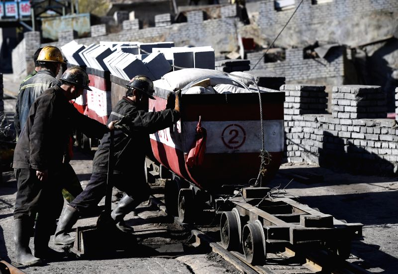 Rescuers transport relief materials into the mine in Jiangjiawan Mine in Datong City, north China's Shanxi Province, April 22, 2015. Nineteen people were confirmed ...