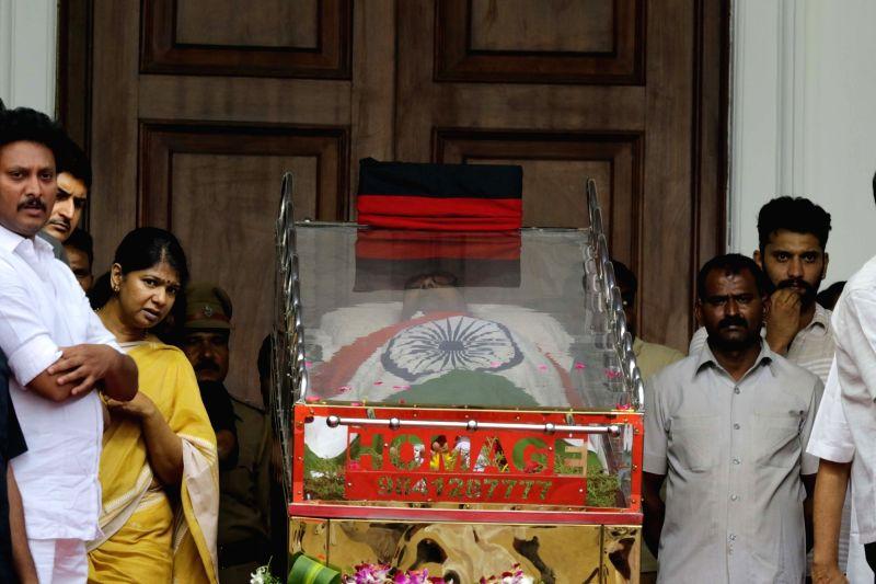 Daughetr Kanimozhi with mortal remains of her father and DMK patriarch M. Karunanidhi at Rajaji Hall in Chennai on Aug. 8, 2018.