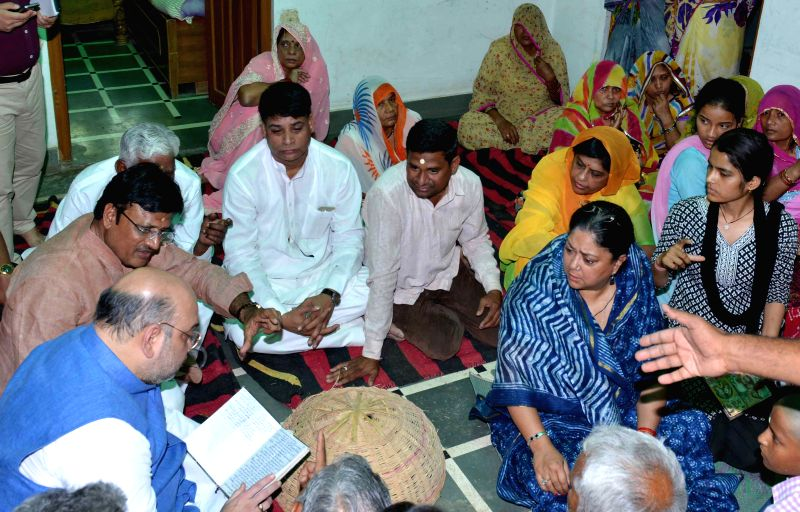 BJP chief Amit Shah and Rajasthan Chief Minister Vasundhara Raje meet the family members of Gajendra Singh Kalyanwat, who committed suicide at Jantar Mantar during an AAP rally on (April 22, ... - Vasundhara Raje and Gajendra Singh Kalyanwat