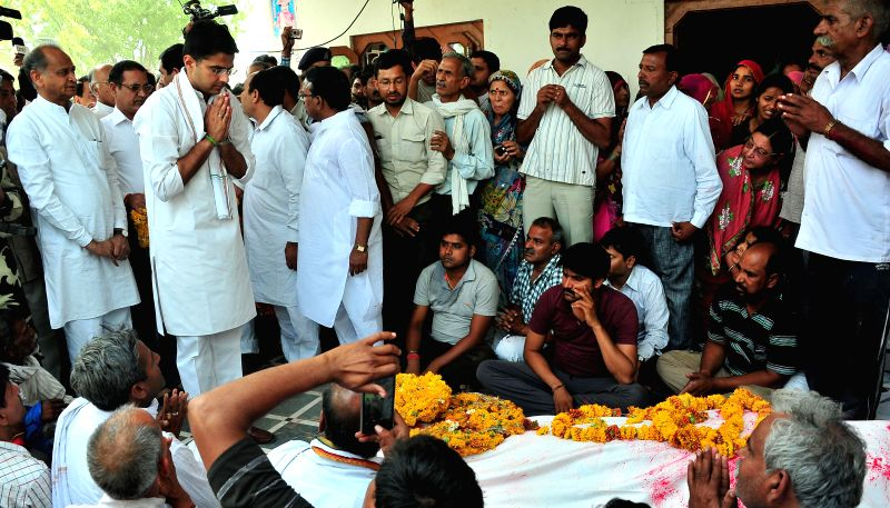 Rajasthan Congress chief Sachin Pilot at the funeral of the farmer who committed suicide at Jantar Mantar during an AAP rally in Delhi, in Nangal Jhamarwada village of Rajasthan's Dausa ...