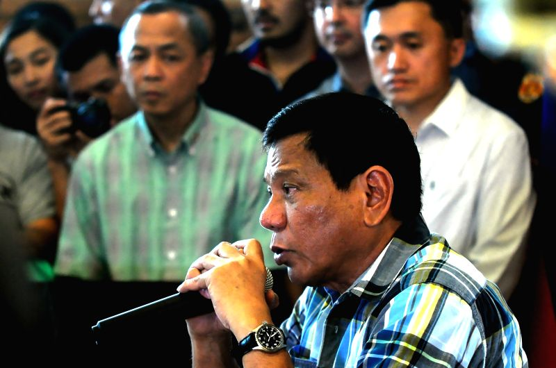 DAVAO PROVINCE, May 16, 2016 - Presumptive Philippine president-elect Rodrigo Duterte speaks during a press conference in Davao Province, the Philippines, May 16, 2016. Duterte said that he wants to ...