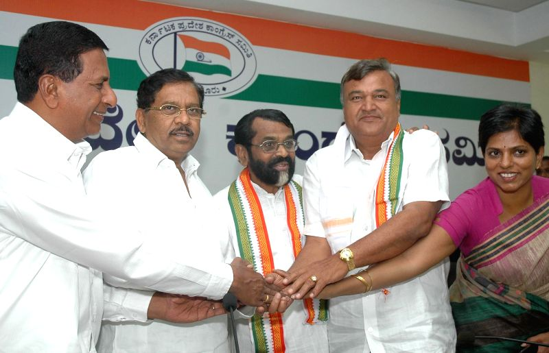 David Simeon, National General Secretary, JD(S) and Syed Jamil Ahmed, JD(S) with a host of JD(S) followers joined Congress party in the presence of G  Parameshwar, president, Karnataka state Congress