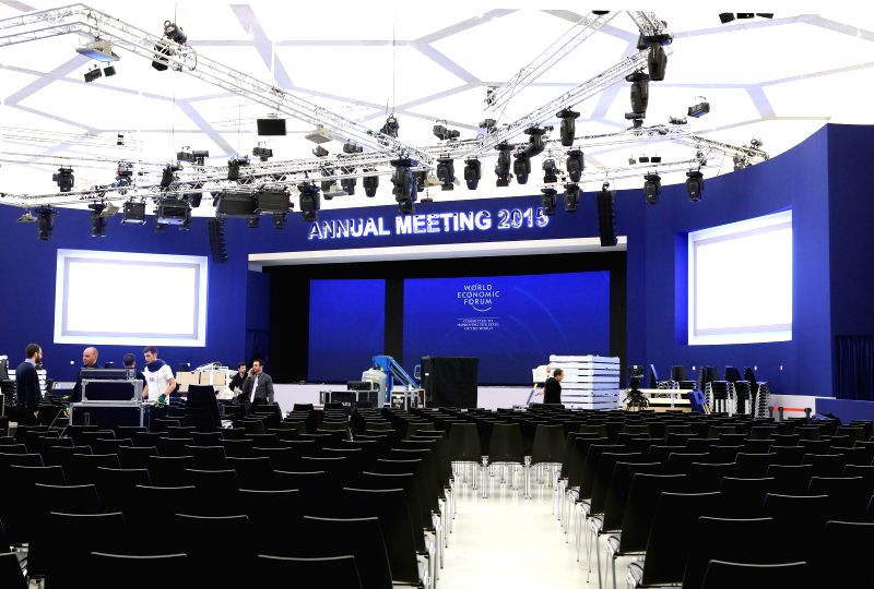 Staff members work at the Congress Center of the World Economic Forum (WEF) annual meetings in Davos, Switzerland, Jan. 20, 2015. About 2,500 people from more than ...