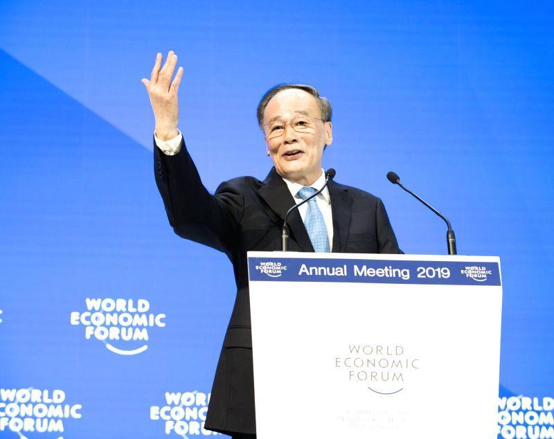 DAVOS, Jan. 23, 2019 (Xinhua) -- Chinese Vice President Wang Qishan addresses the 2019 annual meeting of the World Economic Forum in Davos, Switzerland, on Jan. 23, 2019. (Xinhua/Huang Jingwen/IANS)