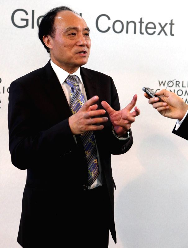 Secretary-general of International Telecommunication Union (ITU) Zhao Houlin speaks during an interview with Xinhua News Agency in Davos, Switzerland, Jan. 23, 2015. .