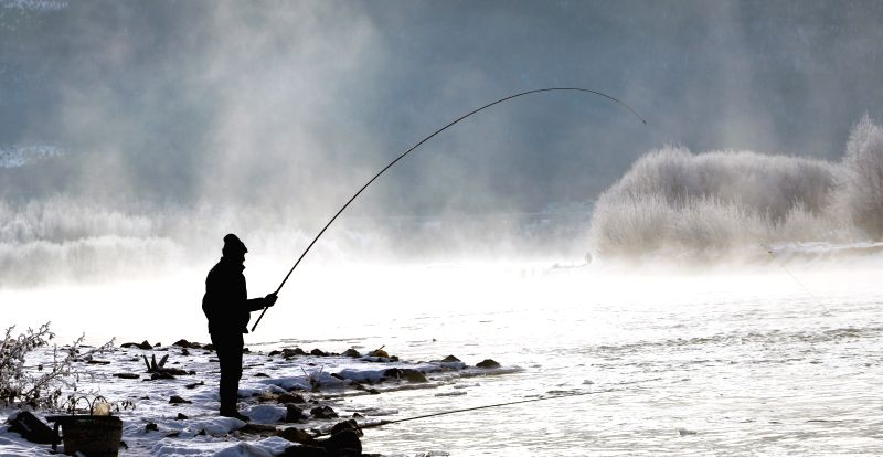 DAXING'A man fishes by Ganhe River with his surroundings decorated by rime from crystalized fog at the Greater Hinggan, northeast China's Heilongjiang Province, Oct. ...