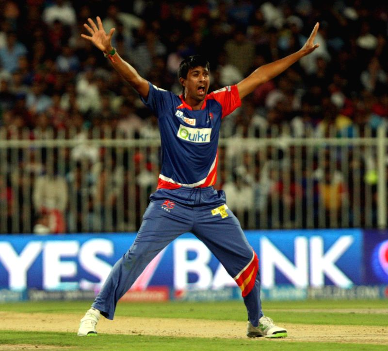 DD bowler Rahul Sharma appeals during the second match of IPL 2014 between Delhi Daredevils and Royal Challengers Bangalore, played at Sharjah Cricket Stadium in Sharjah of United Arab Emirates on ... - Rahul Sharma