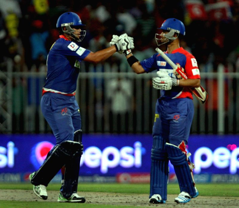 DD players JP Duminy and Ross Taylor congratulates each other during the second match of IPL 2014 between Delhi Daredevils and Royal Challengers Bangalore, played at Sharjah Cricket Stadium in ...