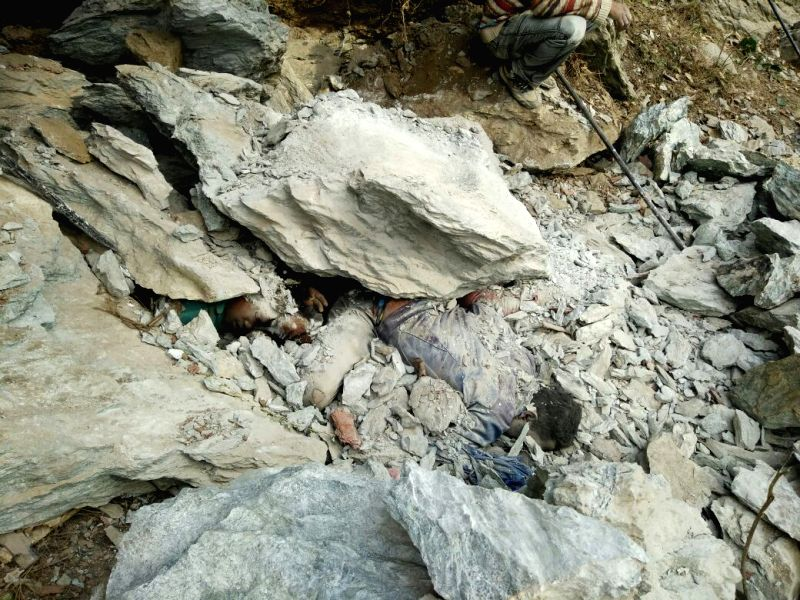 Dead bodies buried under a boulder that collapsed in Vikasnagar of Uttarakhand on May 23, 2016.