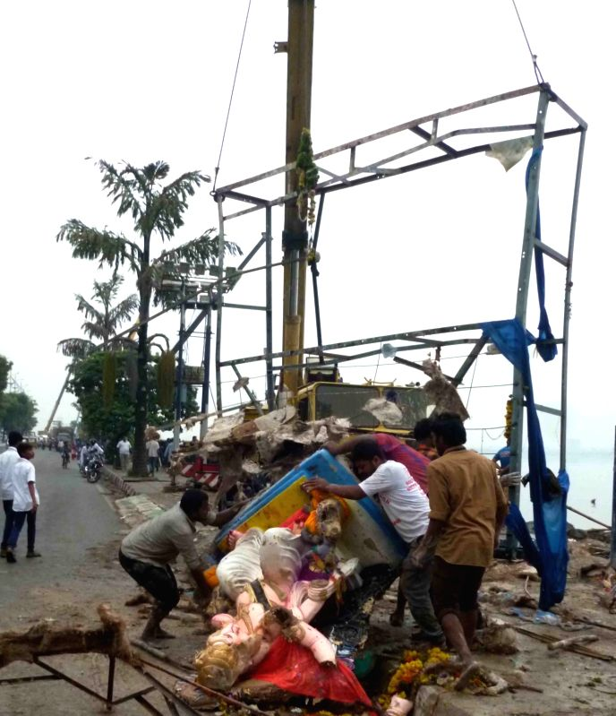 Debris being removed post Ganesh immersion from the Hussain Sagar lake in Hyderabad on Sept 6, 2017.