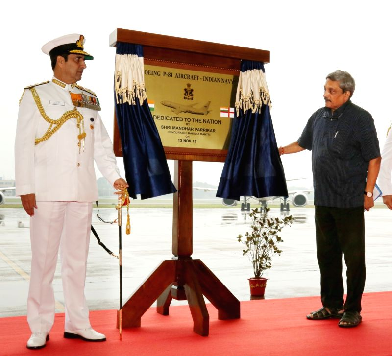 Defence Minister Manohar Parrikar unveils the plaque at the Induction Ceremony of P8i Aircraft at INS Rajali near Chennai on Nov. 13, 2015.