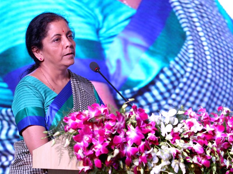 Defence Minister Nirmala Sitharaman addresses after launching projects for Defence Industrial Corridor in Aligarh, Uttar Pradesh on Aug 11, 2018. - Nirmala Sitharaman