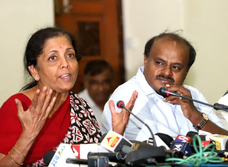 Defence Minister Nirmala Sitharaman addresses a press conference at Conference Hall of Vidhana Soudha, in Bengaluru on Aug 4, 2018. Also seen Karnataka Chief Minister HD Kumaraswamy. - Nirmala Sitharaman