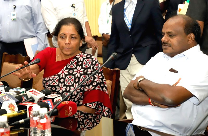 Defence Minister Nirmala Sitharaman and Karnataka Chief Minister HD Kumaraswamy during a press conference at Conference Hall of Vidhana Soudha, in Bengaluru on Aug 4, 2018. - Nirmala Sitharaman