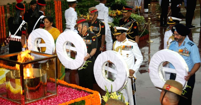 Defence Minister Nirmala Sitharaman, Chief of the Army Staff General Bipin Rawat, Chief of the Naval Staff Admiral Sunil Lanba and Chief of the Air Staff Air Chief Marshal B.S. Dhanoa lay ... - Nirmala Sitharaman