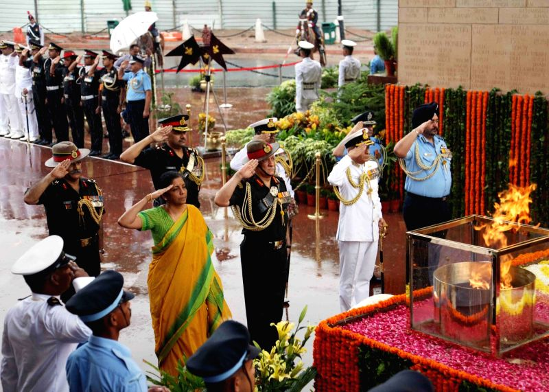 Defence Minister Nirmala Sitharaman, Chief of the Army Staff General Bipin Rawat, Chief of the Naval Staff Admiral Sunil Lanba and Chief of the Air Staff Air Chief Marshal B.S. Dhanoa pay ... - Nirmala Sitharaman