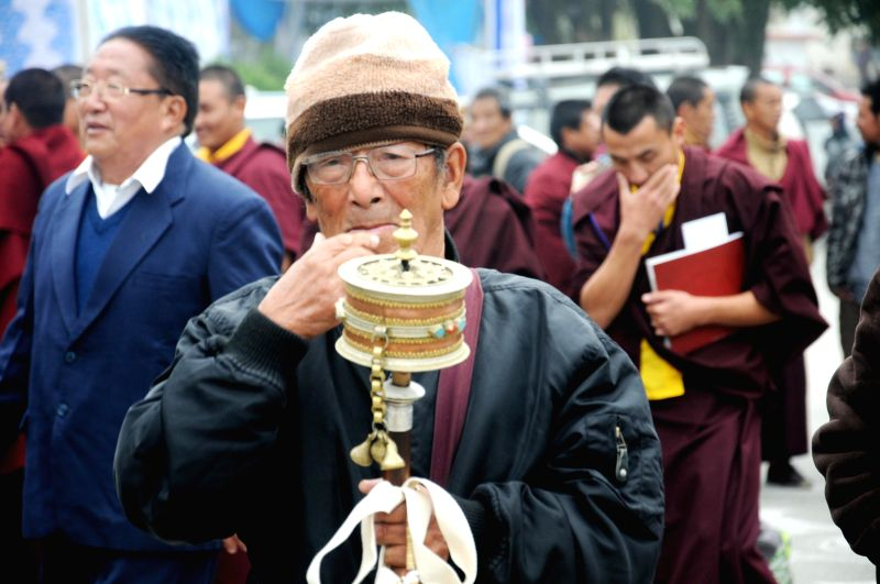 A Buddhist arrives to participate in the Golden Jublee celebrations of Mindrolling Monastery in Dehradun on Jan 6, 2015.