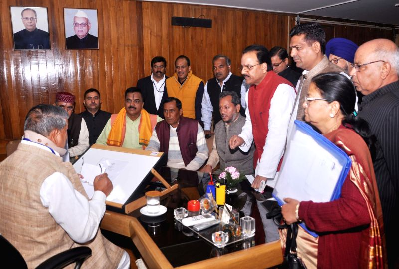 A delegation of BJP MLAs calls on Uttarakhand Chief Minister Harish Rawat in Dehradun, on Nov 25, 2014. - Harish Rawat