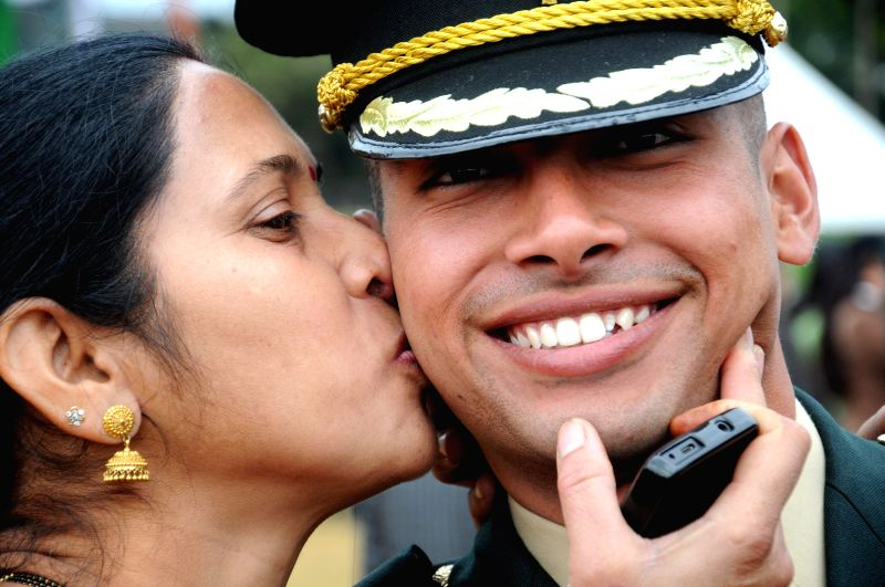 A mother kisses her son during IMA Passing Out Parade in Dehradun on Dec. 13, 2014.