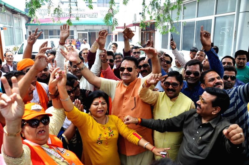 Dehradun: BJP workers celebrate after the counting trends for the 2019 Lok Sabha elections show that the party appeared set to retain power as its candidates led in most of the 542 Lok Sabha constituencies, in Dehradun on May 23, 2019.
