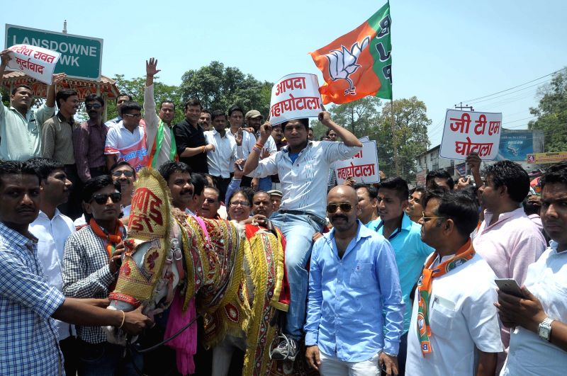 BJP workers stage a demonstration against Uttarakhand Chief Minister Harish Rawat in Dehradun, on June 9, 2015. - Harish Rawat