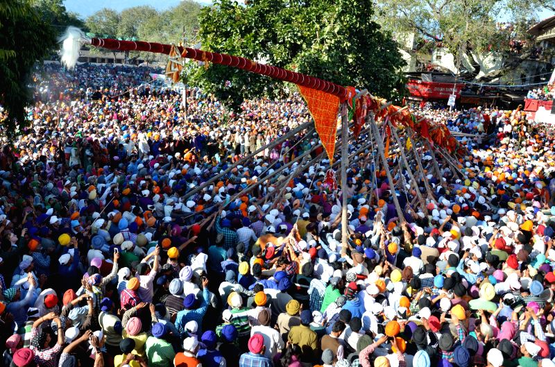 Devotees in large numbers throng Darbar Sahib to participate in the hoisting of `Jhanda` (flag) in Dehradun on March 11, 2015.
