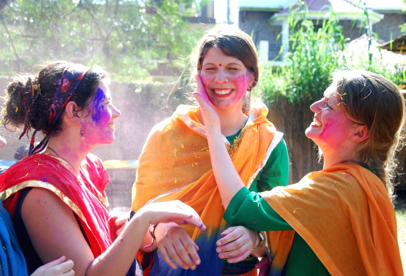 Foreigners celebrate Holi in Dehradun on March 5, 2015.