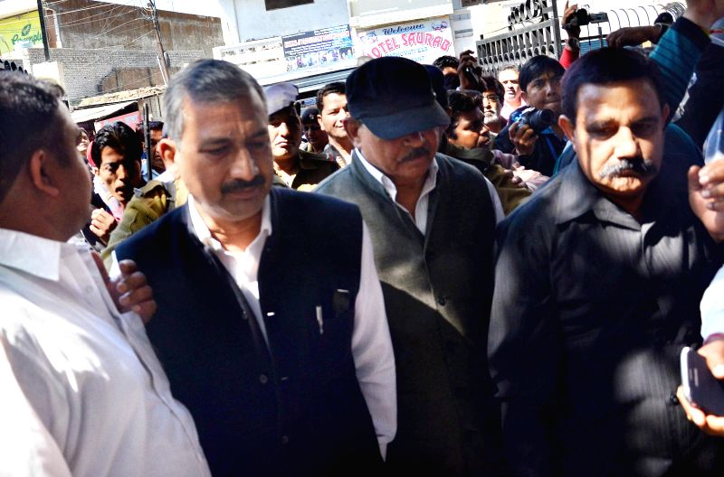 Mafia don-turned-politician D.P. Yadav (wearing cap) arrives to appear before a CBI court in Dehradun, on March 10, 2015. He was sentenced to life imprisonment by the court for his ... - P. Yadav and Mahendra Singh Bhati